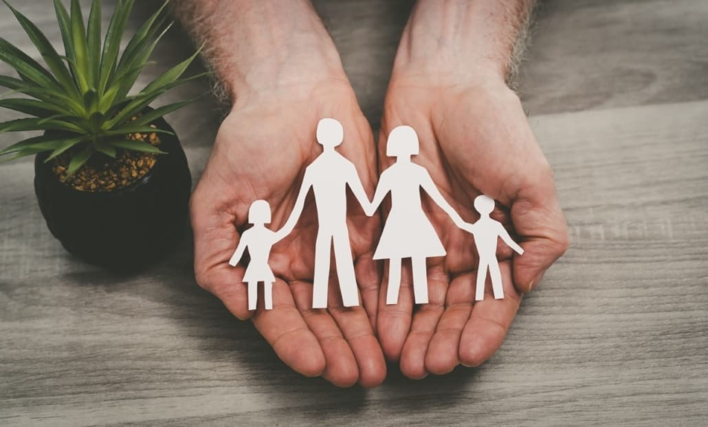 outstretched hands protecting family