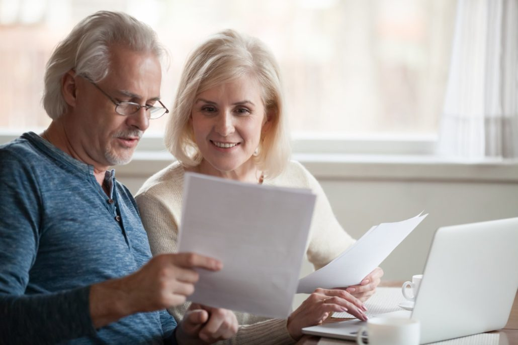 middle aged couple shopping for health insurance rates in Georgia and Tennessee